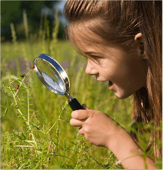 A Girl with Magnifier Photo